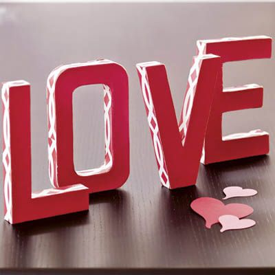 "Say it with papier-mâché letters ($4 each, <a href=""http://www.joann.com/joann/catalog.jsp?CATID=cat1076&PRODID=xprd233323"" target=""_blank"">Joann</a>)  découpaged in pretty paper (Pacon Spectra, $10.89 for 100 sheets,  <a href=""http://store.paper.com/shared/StoreFront/default.asp?CS=paper&StoreType=BtoC&Count1=457210719&Count2=374351143&Keyword=tissue+paper&Target=products.asp&image.x=0&image.y=0"" target=""_blank"">paper.com</a>). Trace the letters onto your paper and cut them out. Use a print for the edges and a solid red for the front and back. Stick the paper shapes onto your letters  using a foam brush and a few top coats of Mod Podge ($4.12 for 8 oz., <a href=""http://www.plaidcraftexpress.com/products/product.aspx?sku=480021"" target=""_blank"">plaidcraftexpress.com</a>)."