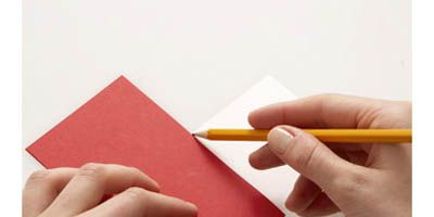"""<p>Cut a 3"""" by 11"""" strip of paper from a piece of colored card stock. Fold the strip in half, so that it measures 3"""" by 5 1/2"""". Repeat this step with a second color of card stock.</p>  <br /><p>Lay one piece of folded card stock on the table in front of you so the fold is to your left. Lay the other folded piece of card stock on top of it at right angles, so the second card's fold is facing you. Mark a light pencil line on the bottom card along the right-hand edge of the top card (see photo).</p> <br /><p>Flip the whole thing over and mark the new bottom card along the new top card's right-hand edge in the same way. </p>"""