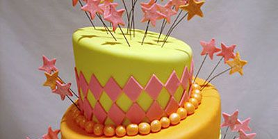 """Go crazy with a topsy-turvy cake in bright colors.  <br /><i>By <a href=""""http://www.pinkcakebox.com"""" target=""""blank"""">Pink Cake Box</a> in Denville, NJ.<br />$715, serves 65</i>"""