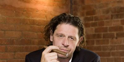 """<p>After years hosting the British version of <i>Hell's Kitchen,</i> Marco Pierre White takes his culinary credo to New York, where he challenges eight teams to compete on NBC's <a href=""""http://www.nbc.com/chopping-block/"""" target=""""_blank""""><b><i>The Chopping Block</i></b></a>. Each week the teams go head-to-head in a restaurant showdown, vying for the cash prize and a chance at opening their very own concept. Given they are under the watch of one of the world's most infamous chefs, let's just say this won't be a cakewalk.</p>"""