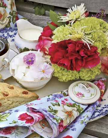 Set up a flower-filled spread for a daytime tea party. Offer a variety of teas and scones served in elegant china with floral-print paper napkins. Let each guest take a teacup as a favor.