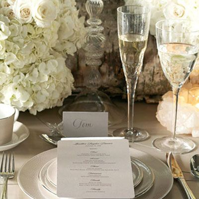 """<p>""""Decide on a color 'story' and carry it through to the china, napkins, flowers, menu,"""" suggests Lhuillier. She also suggests, """"A printed menu on a napkin is a more modern look than a napkin ring — and shows you took the time to plan a wonderful meal."""" And flowers? Says Lhuillier, """"Oh, I love an abundance! And lots and lots and lots of candles."""" </p><br></br>From the Monique Lhuillier Collection for Royal Doulton: Femme Fatale dinnerware and Atelier stemware and flatware&#x3B; available at Bloomingdale's.</p>"""