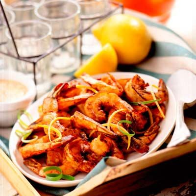 <p>This takes only four minutes on the fire! We added fresh lemon peel to jarred Cajun seasoning. The creamy homemade sauce pairs nicely with the southern-style shrimp.</p><br />