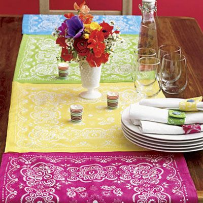 "Add a cheerful touch to the summer table with this patchwork-style runner. Line up enough bandannas to fit the length of a table, leaving some overhang, and stitch together. To back the runner, cut an old cotton tablecloth (any light-colored one will do) to match its width and length. Sew together along the edges or attach with iron-on bonding. Stick with the theme and serve up one of our <b><a href=""http://www.delish.com/recipes/cooking-recipes/top-rib-recipes""target=""_new"">top rib recipes</a></b>!"