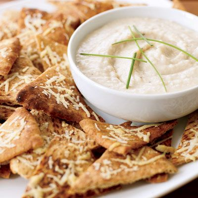 """<p>This pureed white bean dip, shown here with <a href=""""/recipefinder/parmesan-pita-crisps"""" target=""""_blank""""><b>Parmesan Pita Crisps</b></a>, is the perfect treat to have on hand for picnics. As an added munchie bonus, the crispy homemade pita chips are perfect for dipping, but also flavorful enough to hold their own.</p><br /><p><b>Recipe: <a href=""""/recipefinder/white-bean-dip"""" target=""""_blank"""">White Bean Dip</a></b></p>"""