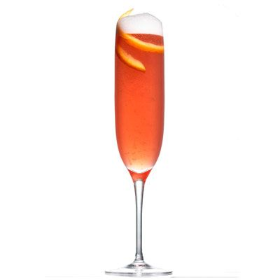 """A twist on the classic mimosa, this champagne cocktail is full of sweet and bitter orange flavors from Cointreau and fresh orange juice. And pomegranate liqueur adds a bit of sweetness. Top it off with orange zest.<br /><br /><b>Recipe: <a href=""""/recipefinder/champagne-dream-recipe"""" target=""""_blank"""">Champagne Dream</a></b><br /><br /><i>Dale DeGroff, author of</i> The Craft of the Cocktail"""