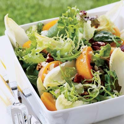 "<p>A great light start to a meal, this party-perfect salad features jewel-toned apricots, toasted pecans, and Belgian endive, all dressed in a delicate Champagne vinaigrette.</p><br /><p><b>Recipe: <a href=""/recipefinder/greens-apricots-champagne-vinaigrette"" target=""_blank"">Mixed Greens with Apricots and Champagne Vinaigrette</a></b></p>"
