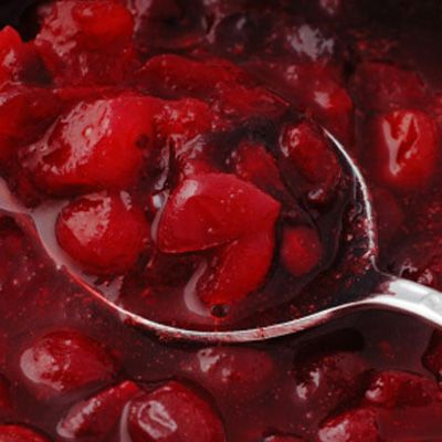 In 2-quart casserole, combine a 12-ounce package of fresh cranberries, 3/4 cup sugar, and 1/4 cup orange juice or water. Cover with lid or vented plastic wrap, and microwave 7 to 11 minutes until cranberries pop.