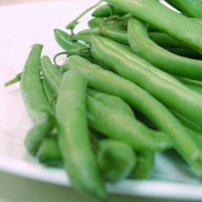 Cook 1 pound green beans and a few tablespoons water in a covered casserole for 4 to 6 minutes until tender-crisp.