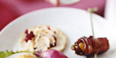 """<p>A dazzling main event deserves an equally appealing, well-crafted hors d'oeuvre. These salty, smoky morsels composed of bacon, pistachios, and dried fruit are guaranteed to whet appetites, not ruin them.</p><br /><p><b>Recipe: <a href=""""/recipefinder/bacon-wrapped-dates-recipe"""" target=""""_blank"""">Bacon-Wrapped Dates</a></b>"""