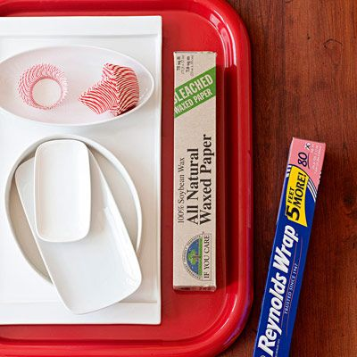 If you plan to transfer cookies to new vessels for serving, be creative — a bowl or butter dish works as well as a platter; cupcake liners can group tiny treats. Time to send guests packing? Provide plastic wrap or foil so folks can reuse their own carriers.