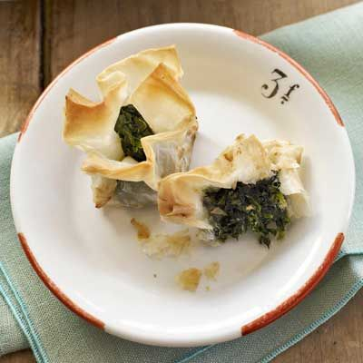 "<p>Frozen spinach, a freezer staple, and full-flavored Italian cheese are wrapped in phyllo purses and baked until golden.</p><br /><p><b>Recipe: <a href=""/recipefinder/spinach-taleggio-bites-recipe"" target=""_blank"">Spinach-Taleggio Bites</a></b></p>"