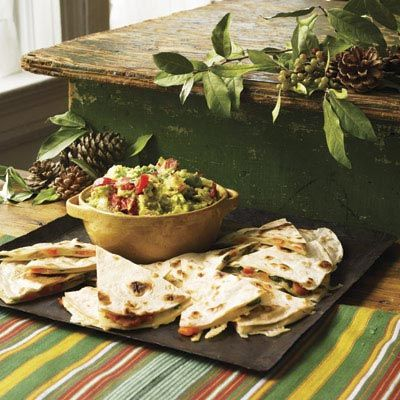 "Try savory quesadilla appetizers stuffed with Monterey Jack cheese, red peppers, and poblano peppers. Serve with creamy guacamole.<br /><br /><b>Recipe: <a href=""/recipefinder/roasted-red-green-pepper-quesadillas-recipe"" target=""_blank"">Roasted Red and Green Pepper Quesadillas</a></b>"