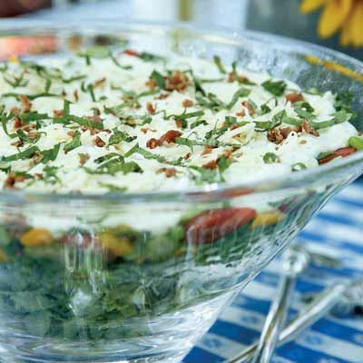 "<p>This makeover of a Midwestern classic tops layers of lettuce, peas, bell pepper, and tomatoes with a creamy, tangy dressing. The salad stays fresh underneath until it's served and gets even better when held overnight. </p><br /><p><b>Recipe: </b><a href=""/recipefinder/seven-layer-salad-recipe-6851"" target=""_blank""><b>Seven-Layer Salad</b></a></p>"