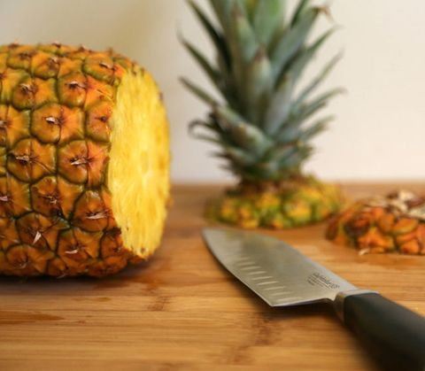 <p>Rotate the pineapple and cut off the bottom. This way, the pineapple can stand up on either end.</p>
