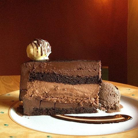 """<p><b>Where you'll find it:</b> <a href=""""http://www.thetrellis.com/"""" target=""""_blank"""">The Trellis Restaurant</a>, Williamsburg, VA ($10.95 per slice)</p><p><b>The chocolaty details:</b> One layer of chocolate? Boring. Two layers? Still not enough. Three? C'mon — that's for amateur chocolate eaters. This torte features <i>seven</i> different chocolate layers. And because that's just not enough chocolate, it comes with hand-rolled white chocolate truffle, chocolate ice cream, and a dark chocolate sauce. Check, please!</p>"""