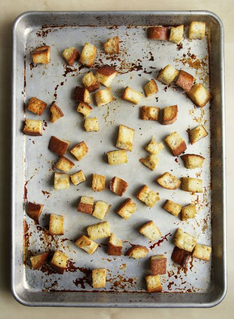 Stop! Don't toss out that loaf of stale bread that's sitting on your counter. Instead, give it a new life by transforming it into shatteringly crisp croutons — it only takes a few minutes, and the results are far tastier than store-bought varieties. Whether you have half a loaf of bread leftover or only a few slices, the technique is simple and scalable.