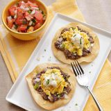 black bean and chipotle tostadas with creme fraiche