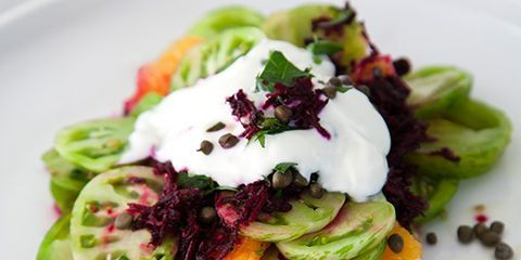 """<p>Thinly sliced green tomatoes and oranges get stacked together, then topped with a generous dollop of yogurt and shredded beets in this quick, colorful snack.</p><p><strong>Recipe:</strong> <a href=""""http://www.delish.com/recipefinder/green-tomato-citrus-stacks-beet-stained-yogurt-recipe-fw0614""""><strong>Green Tomato-Citrus Stacks with Beet-Stained Yogurt </strong></a></p>"""