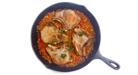 """<p>We trimmed fat and calories from the original pork chops and rice casserole (made with condensed soups) and added a ton of extra flavor using onions, bell peppers, and paprika.</p><p><strong>Recipe:</strong> <a href=""""http://www.delish.com/recipefinder/pork-chop-wild-rice-skillet-casserole-recipe-ghk0314"""" target=""""_blank""""><strong>Pork Chop and Wild Rice Skillet Casserole</strong></a></p>"""