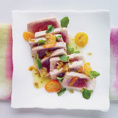 "<p>This incredibly quick and easy dish from New Orleans chef Donald Link's <i>Down South</i> cookbook features tuna steaks poached until rare in a bright, buttery sauce that's infused with tangy lime and kumquats, spicy jalapeños, and fresh mint. Doubled or tripled, it would make an excellent dinner-party dish.</p><p><strong>Recipe:</strong> <a href=""http://www.delish.com/recipefinder/poached-tuna-kumquats-jalapeno-recipe-fw0314""><strong>Poached Tuna with Kumquats and Jalapeño</strong></a></p>"