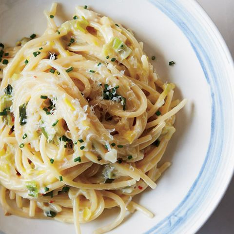 "<p>Instead of boiling pasta in water, blogger Ashley Rodriguez cooks it in a super-flavorful combination of stock, cream, leeks, scallion, garlic, and chives.</p><p><strong>Recipe:</strong> <a href=""http://www.delish.com/recipefinder/creamy-one-pot-spaghetti-leeks-recipe-fw0414""><strong>Creamy One-Pot Spaghetti with Leeks</strong></a></p>"
