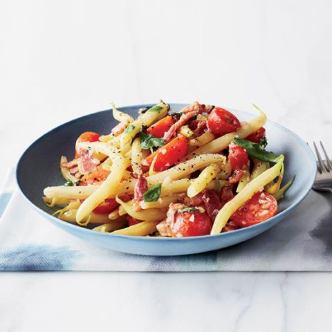 "<p>This clever wax bean dish is a cross between a salad and a side dish: it's served warm but loaded with the bright, fresh flavors of tomatoes and basil.</p><p><strong>Recipe:</strong> <a href=""warm-yellow-wax-beans-bacon-vinaigrette-recipe-fw0414""><strong>Warm Yellow Wax Beans in Bacon Vinaigrette</strong></a></p>"