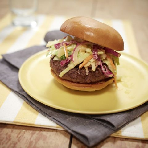 "<p>These grilled burgers are topped with a homemade, sweet-and-spicy slaw.</p> <p><b>Recipe: <a href=""http://www.delish.com/recipefinder/miracle-whip-slaw-burgers-recipe-mw0414"">MIRACLE WHIP Slaw Burgers</a></b></p>"