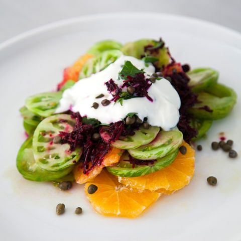 "<p>Thinly sliced green tomatoes and oranges get stacked together, then topped with a generous dollop of yogurt and shredded beets in this quick, colorful snack.</p><p><strong>Recipe:</strong> <a href=""http://www.delish.com/recipefinder/green-tomato-citrus-stacks-beet-stained-yogurt-recipe-fw0614""><strong>Green Tomato-Citrus Stacks with Beet-Stained Yogurt </strong></a></p>"