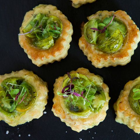 "<p>These beautiful tarts are filled with creamy smoked cheddar cheese and roasted green tomatoes for an easy, delicious snack.</p><p><strong>Recipe:</strong> <a href=""http://www.delish.com/recipefinder/roasted-green-tomato-smoked-cheddar-tarts-recipe-fw0614""><strong>Broiled </strong></a></p>Roasted Green Tomato and Smoked Cheddar Tarts"
