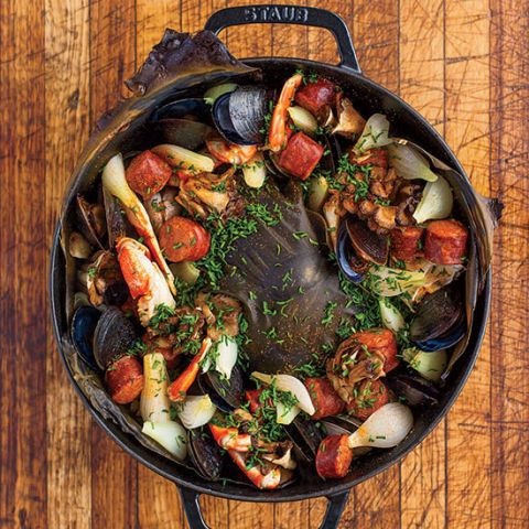 "<p>To capture the authentic flavors of a real clambake, the whizzes at the ChefSteps cooks' collective created a version using a cast-iron casserole, Japanese kombu, charred wood chips, and a hefty rock.</p><p><strong>Recipe:</strong> <a href=""http://www.delish.com/recipefinder/ultimate-oven-clambake-recipe-fw0714""><strong>Ultimate Oven Clambake</strong></a></p>"