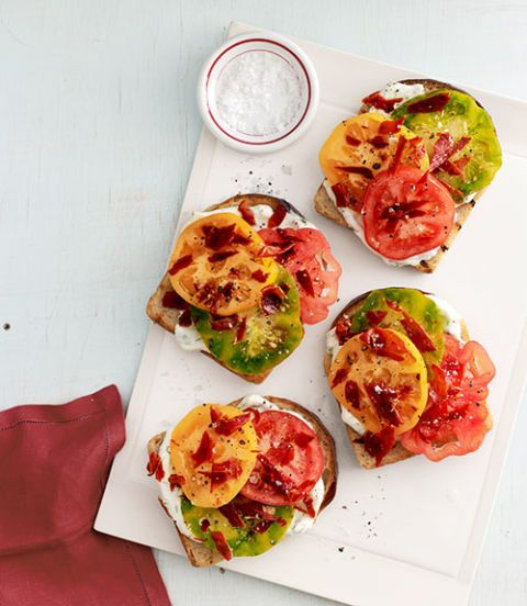 "<p>Though this sandwich is fresh and light, prosciutto keeps it satisfying and substantial enough to make it a filling summer lunch.</p> <p><strong>Recipe:</strong> <a href=""http://www.countryliving.com/recipefinder/heirloom-tomato-sandwiches-recipe-clv0913"" target=""_blank""><b>Heirloom-Tomato Sandwiches</b></a></p>"
