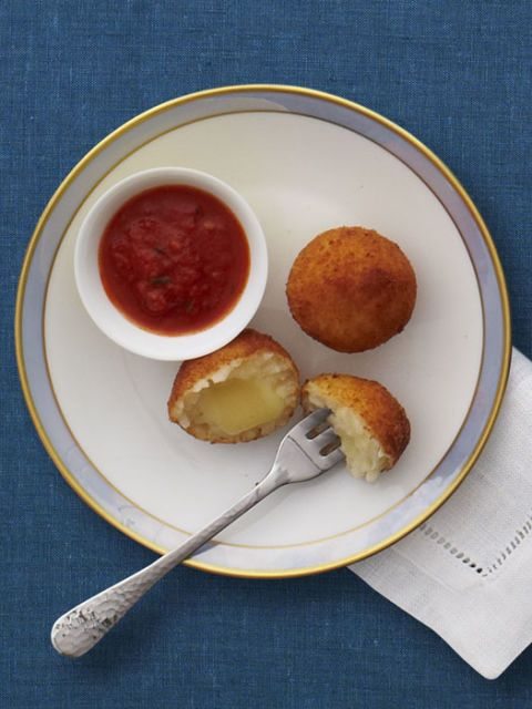 "<p>Arancini are a classic Italian treat. Stuffed with creamy Fontina and then deep-fried and served with marinara for dipping, this is one bite-sized treat that will please young and old, and everyone in between.</p><br /><p><b>Recipe:</b> <a href=""/recipefinder/mini-arancini-recipe-rbk1211"" target=""_blank""><b>Mini Arancini</b></a></p>"