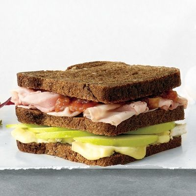 ham brie and apple triple decker sandwich