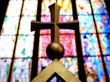 Blue, Glass, Yellow, Stained glass, Fixture, Symbol, Cross, Holy places, Symmetry, Place of worship,