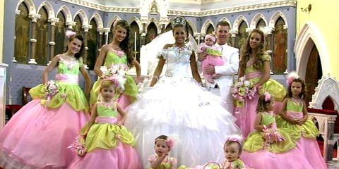 Clothing, Dress, Human body, Event, Petal, Purple, Photograph, Pink, Formal wear, Arch,