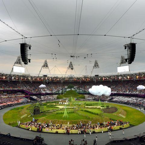 Crowd, People, Sport venue, Electricity, Stadium, Audience, Urban area, Pole, Fan, Urban design,