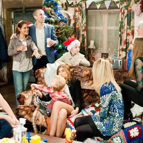 Human, Holiday, Sharing, Living room, Interior design, Toy, Lap, Party, Christmas, Fur,