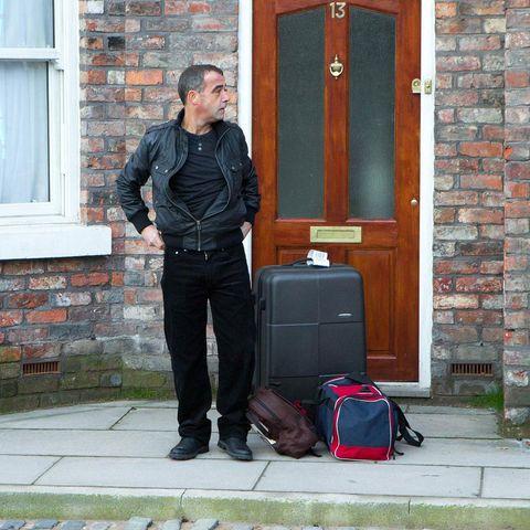 Brick, Door, Luggage and bags, Brickwork, Fixture, Home door, Jacket, Street fashion, Bag, Wood stain,
