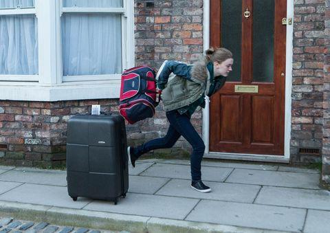 Jeans, Standing, Jacket, Door, Brick, Bag, Fixture, Luggage and bags, Street fashion, Brickwork,