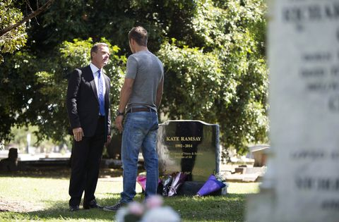 Grass, Shirt, Coat, Jeans, Suit, People in nature, Headstone, Blazer, Memorial, Groundcover,