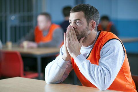 Table, Sitting, Orange, Wrist, Beard, Facial hair, Varnish, Desk, Thinking, Student,