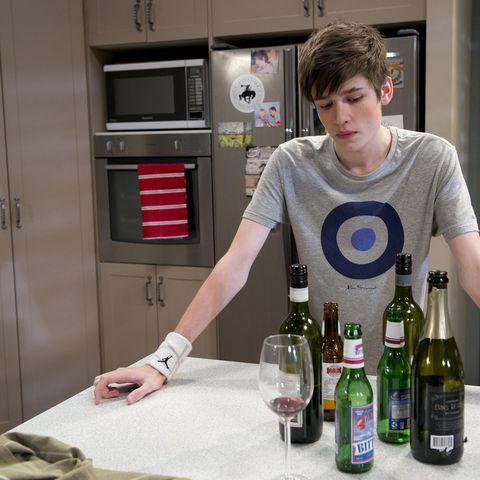 Glass bottle, Bottle, Drink, Alcohol, Drinkware, Alcoholic beverage, Barware, Distilled beverage, Logo, Door,