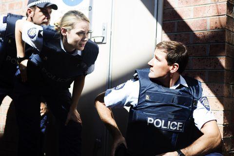 Arm, Human body, Cap, Wrist, Law enforcement, Police, Brick, Helmet, Glove, Job,
