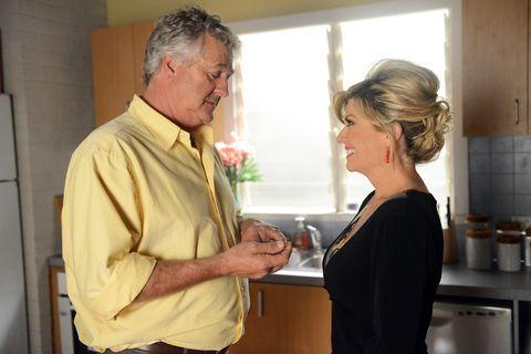 Dress shirt, Collar, Interaction, Conversation, Countertop, Greeting, Kitchen appliance, Kitchen, Belt, Flower Arranging,
