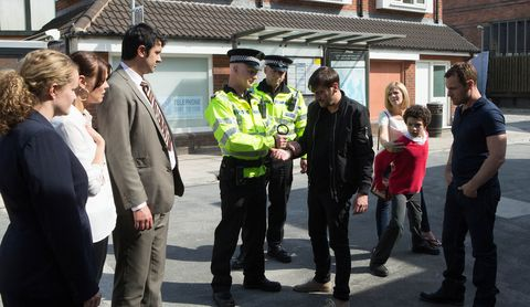 Jeans, Military uniform, Uniform, Police officer, Security, Police, Law enforcement, Official, High-visibility clothing, Conversation,