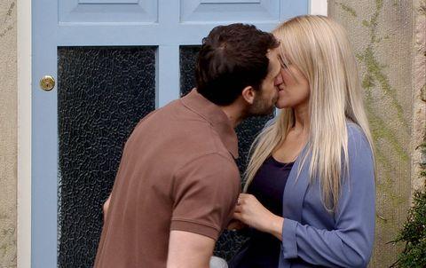 Ear, Kiss, Romance, Interaction, Love, Honeymoon, Gesture, Door, Blond, Home door,