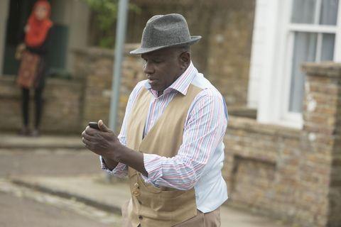 Hat, Dress shirt, Sleeve, Collar, Shirt, Street fashion, Sun hat, Brick, Beige, Fedora,
