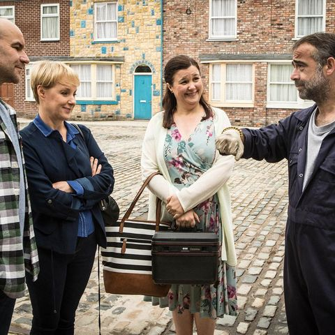 Window, Luggage and bags, Bag, Jacket, Handbag, Street fashion, Conversation, Beard, Brick, Sash window,