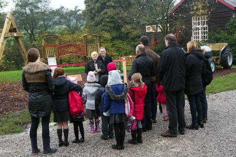 Plant, Leisure, Public space, Child, Boot, Jacket, Human settlement, Garden, Pole, Park,